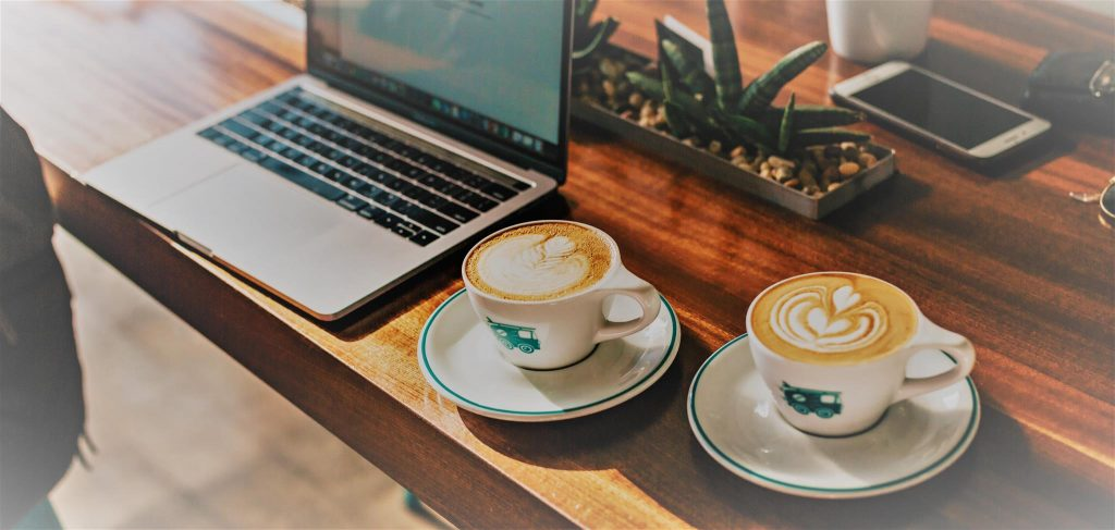 Using laptop and coffees