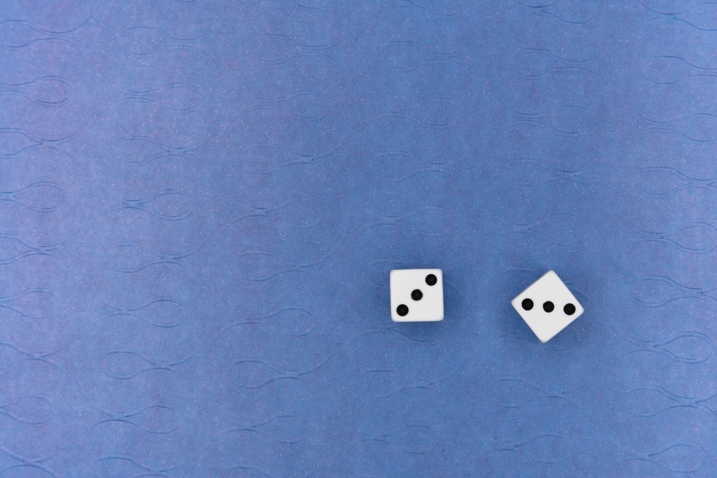 Dices on a blue background   MAP Lawyers