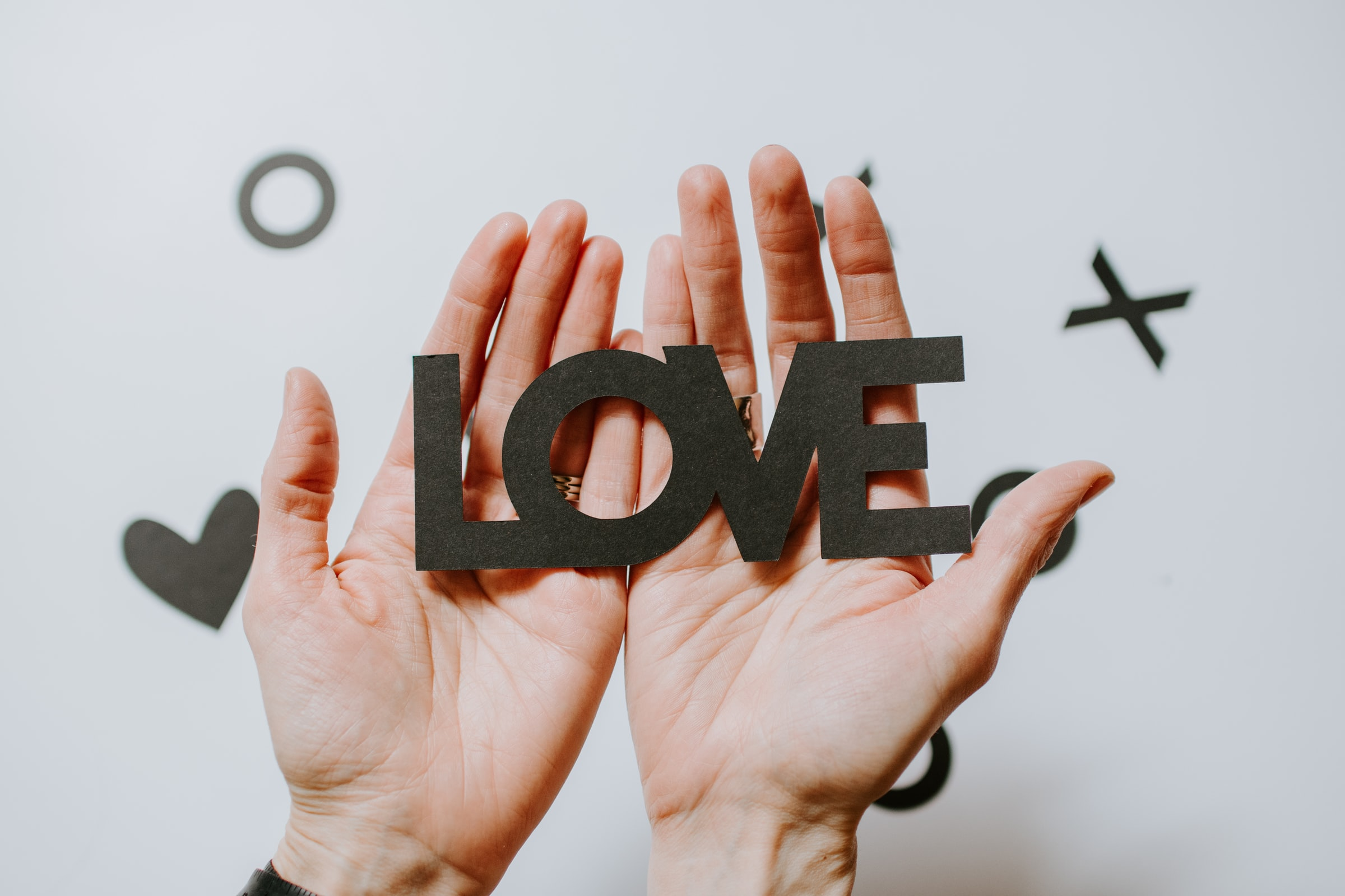 Hands holding the word Love | MAP Lawyers
